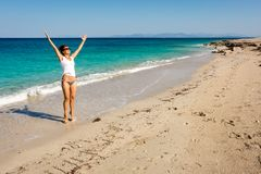 Happy adult woman  enjoing about holiday spent on the sea beach. In Greece Stock Image