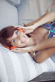 Happy adult woman with headphones. Happy adult woman smiling with headphones Royalty Free Stock Photos