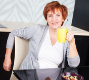 Happy adult woman on kitchen Royalty Free Stock Photography