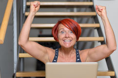 Happy Adult Woman with Laptop Raising her Arms Royalty Free Stock Photos