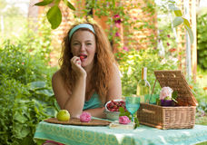 Happy adult woman resting in garden outdoors Stock Photos