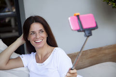 Happy adult woman taking a self portrait Stock Photography