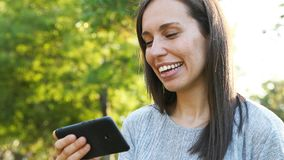 Happy adult woman watching video on smart phone stock video