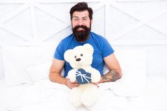 Happy adulthood. home shopping concept. Love and happiness. bearded man teddy bear in bed. Gift box for holidays. nice