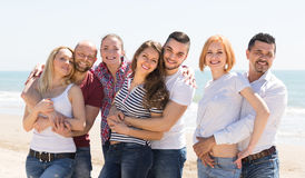 Happy adults at beach Stock Photo
