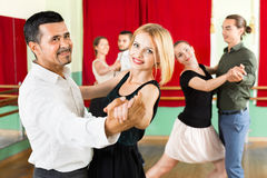 Happy adults enjoying of classical dance royalty free stock photo