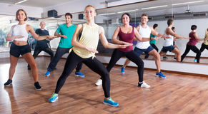 Happy adults having group fitness class. In the sport club Royalty Free Stock Photography
