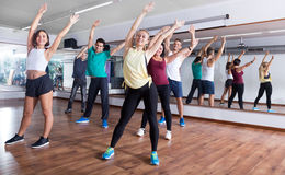 Happy adults having group fitness class. In sport club Royalty Free Stock Images