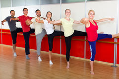 Happy adults learning to dance ballet Royalty Free Stock Image