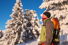 Happy adventurer stands in the winter mountains stock photos