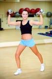 Happy aerobic. Happy woman makes aerobic with dumbbells Royalty Free Stock Photos