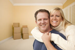 Happy Affectionate Couple in Room of New House with Boxes Royalty Free Stock Photo