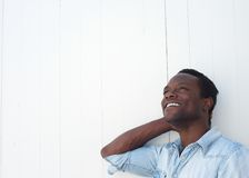 Happy african american adult smiling with joy Stock Image
