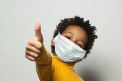 Free Happy African American Black Kid In Medical Protective Face Mask Showing Thumb Up On White Royalty Free Stock Images - 190212389