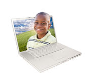 Happy African American Boy in Laptop. Screen Isolated on White Stock Image