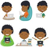 Happy African American boys with laptops. stock image