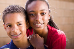 Happy African American brother and sister smiling. Portrait of an African American brother and sister Stock Image
