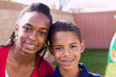 Happy African American brother and sister smiling. Portrait of an African American brother and sister Royalty Free Stock Image