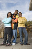 Happy African American brother and sisters smiling. Stock Image