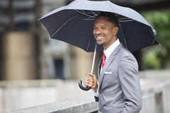 Happy African American Businessman Holding Umbrella Royalty Free Stock Images