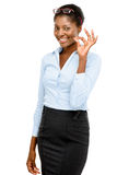 Happy African American businesswoman okay sign isolated on white Stock Photography