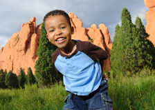 Happy African American Child. Playing in a meadow Stock Photo