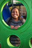 Happy African American child playing outside. Cute young African American girl playing at a school playground Stock Photos