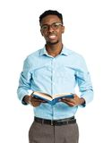 Happy african american college student with book in his hands st Stock Photos