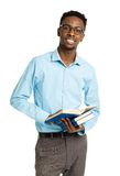 Happy african american college student with books standing on wh Stock Photos
