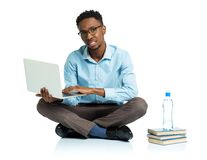 Happy african american college student with laptop, books and bo Stock Photography