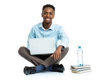 Happy african american college student with laptop, books and bo Stock Photo