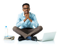Happy african american college student with laptop, books and bo Stock Images