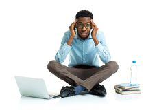 Happy african american college student with laptop, books and bo Stock Photos