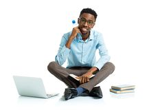 Happy african american college student with laptop Stock Photos