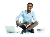 Happy african american college student with laptop Royalty Free Stock Images