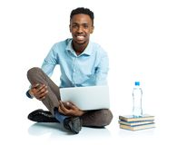 Happy african american college student with laptop Royalty Free Stock Photography