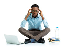 Happy african american college student with laptop, books sittin Royalty Free Stock Images