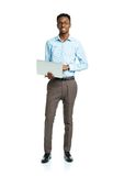 Happy african american college student with laptop standing on w Royalty Free Stock Photo