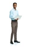 Happy african american college student with laptop standing on w Royalty Free Stock Images