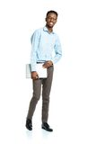 Happy african american college student with laptop standing on w Stock Images
