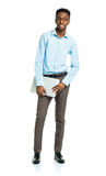 Happy african american college student with laptop standing on w Stock Photography