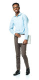 Happy african american college student with laptop standing on w Royalty Free Stock Photography
