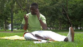 Happy African American College Student with phone stock footage