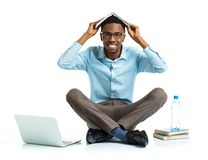 Happy african american college student sitting with laptop and b Royalty Free Stock Photos