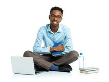 Happy african american college student sitting with laptop on wh Royalty Free Stock Images