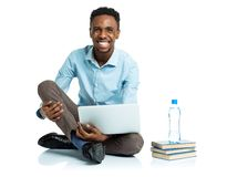 Happy african american college student sitting with laptop on wh Stock Photo