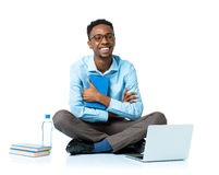 Happy african american college student sitting with laptop on wh Royalty Free Stock Image