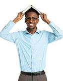Happy african american college student standing with book on his Royalty Free Stock Image