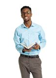 Happy african american college student standing with book on whi Royalty Free Stock Photography