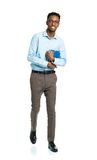 Happy african american college student standing with books in hi Royalty Free Stock Photos